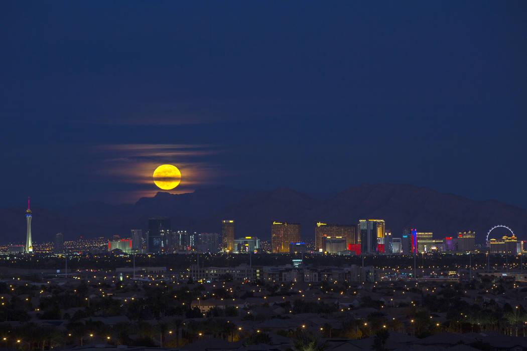 A 'Cold' full moon rises over Las Vegas on Saturday, Dec. 22, 2018. (Richard Brian/Las Vegas Review-Journal via AP)