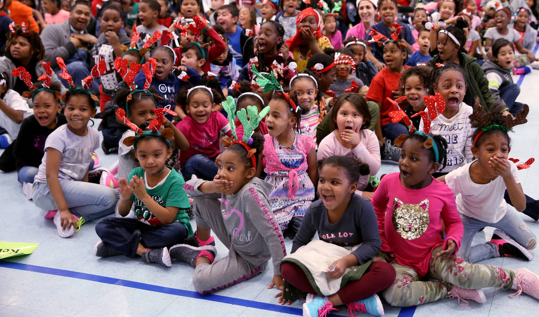 Students react to seeing new toys on stage during a school-wide assembly where they received toys and treats at Matt Kelly Elementary School in Las Vegas Thursday, Dec. 20, 2018. Local philanthrop ...