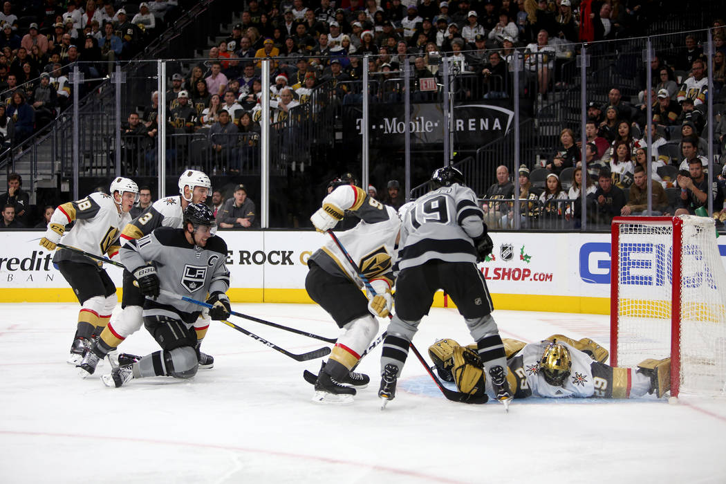 Los Angeles Kings Anze Kopitar (11) shoots at the goal past Vegas Golden Knights Colin Miller (6) during a game at T-Mobile Arena in Las Vegas, Sunday, Dec. 23, 2018. Kings won 4-3 in overtime. Ra ...