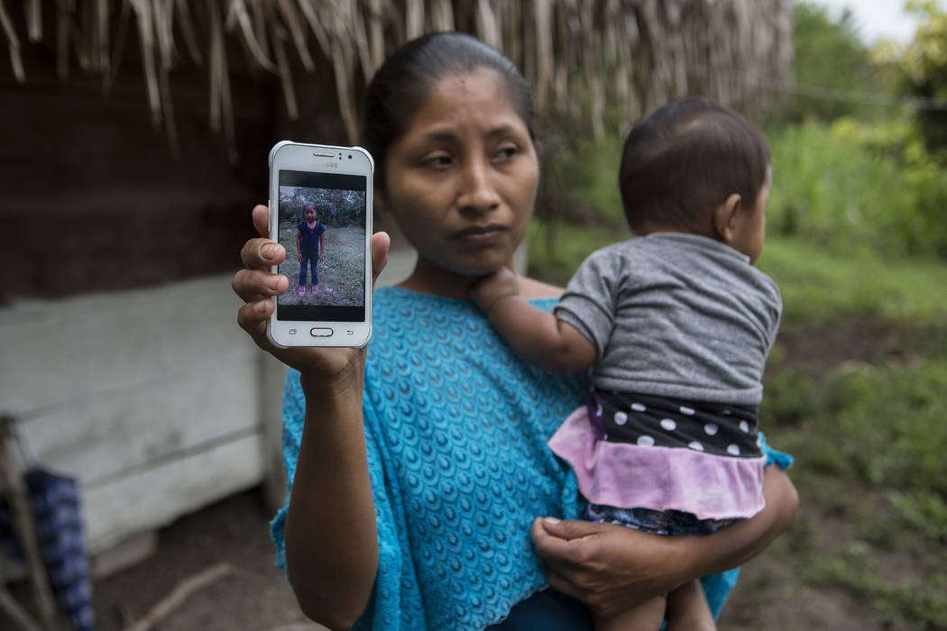 Claudia Maquin, 27, shows a photo of her daughter, Jakelin Amei Rosmery Caal Maquin in Raxruha, Guatemala, on Saturday, Dec. 15, 2018. The 7-year-old girl died in a Texas hospital, two days after ...