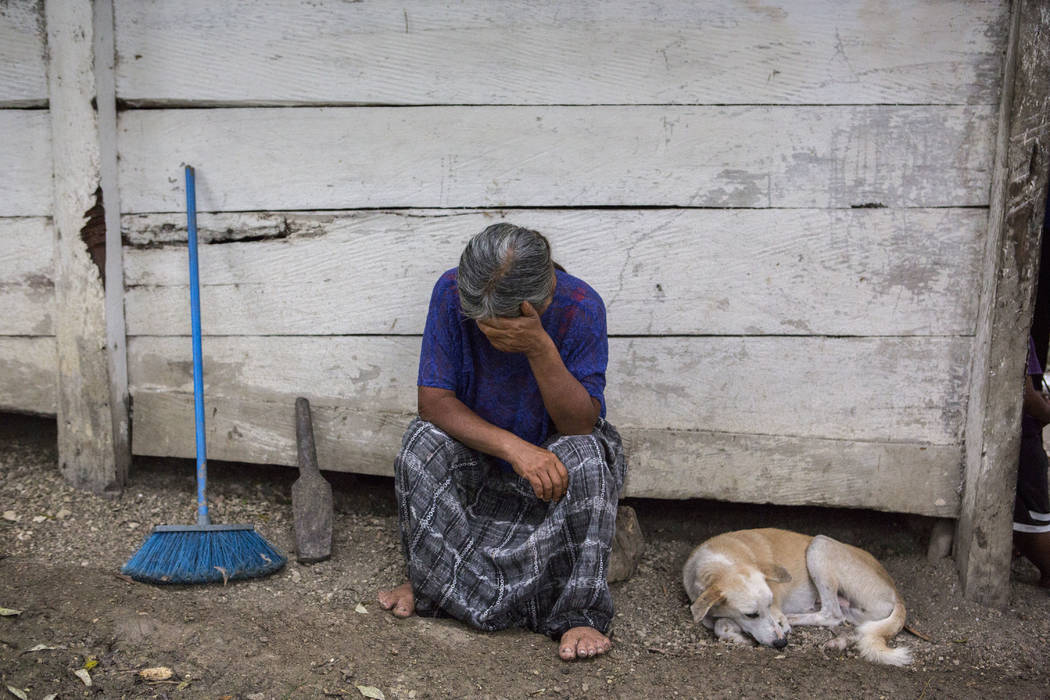 Elvira Choc, 59, Jakelin Amei Rosmery Caal's grandmother, rests her head on her hand in front of her house in Raxruha, Guatemala, on Saturday, Dec. 15, 2018. The 7-year old girl died in a Texas ho ...