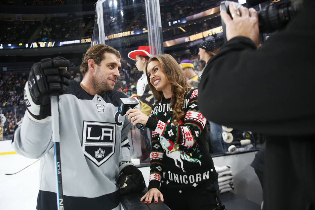 Alyson Lozoff, the rinkside reporter for the Vegas Golden Knights, interviews Los Angeles Kings Anze Kopitar before the game against Vegas Golden Knights at T-Mobile Arena in Las Vegas, Sunday, De ...