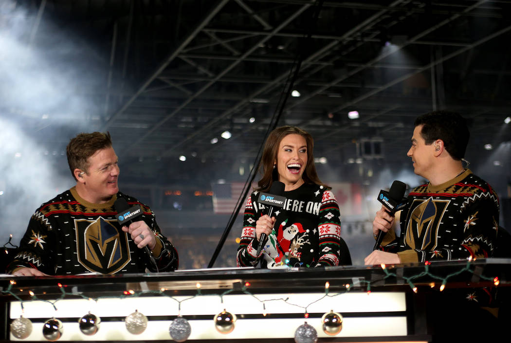 Alyson Lozoff, the rinkside reporter for the Vegas Golden Knights, center, speaks to fellow hosts Brad May, left, and Nick Gismondi, right, for the pre-game broadcast for AT&T SportsNet at T-M ...