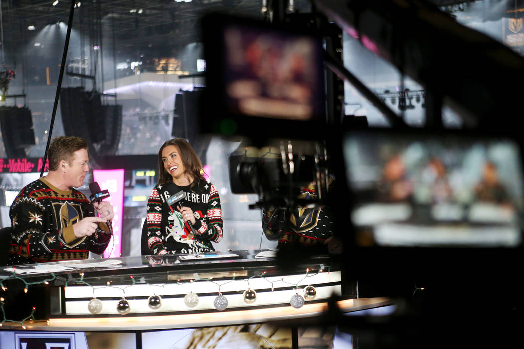 Alyson Lozoff, the rinkside reporter for the Vegas Golden Knights, center, speaks to fellow host Brad May for the pre-game broadcast for AT&T SportsNet at T-Mobile Arena in Las Vegas, Sunday, ...