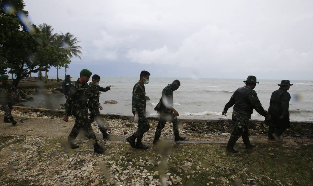 Indonesian soldiers search the tsunami victims at a beach resort in Tanjung Lesung, Indonesia, Monday, Dec. 24, 2018. Doctors are working to help survivors and rescuers are looking for more victim ...