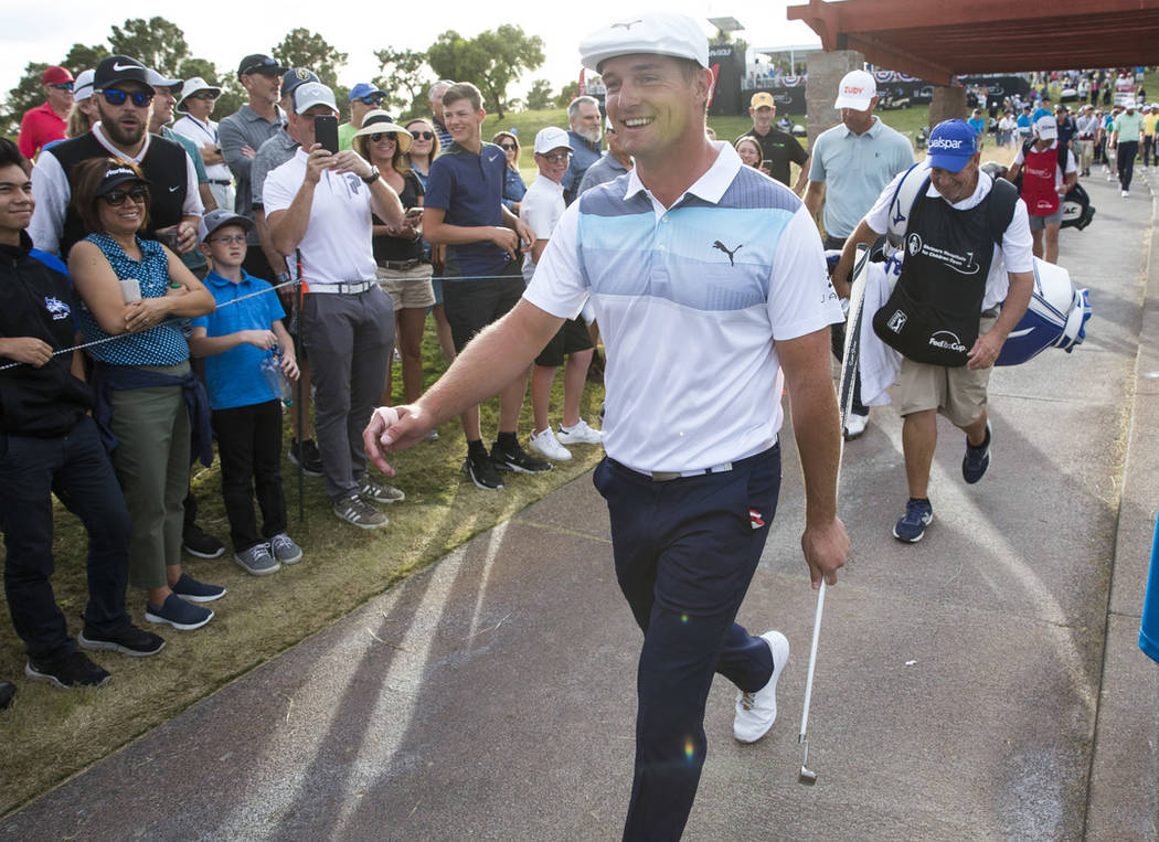American golfer Bryson DeChambeau walks to the fairway after teeing off from the 17th box during the final round of the Shriners Hospitals for Children Open at TPC at Summerlin in Las Vegas on Sun ...
