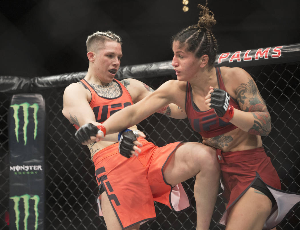 "Macy Chiasson, left, lands a kick against Pannie Kianzad during the first round of ""The Ultimate Fighter"" Season 28 Finale on Friday, Nov. 30, 2018, at The Pearl, at Palms, in Las ..."