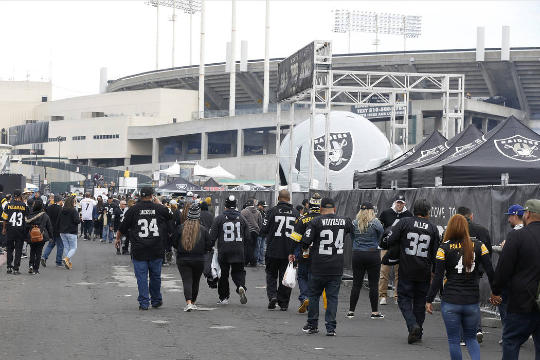 Fans tailgate outside of Oakland Alameda County Coliseum before an NFL football game between the Oakland Raiders and the Pittsburgh Steelers in Oakland, Calif., Sunday, Dec. 9, 2018. (AP Photo/D. ...