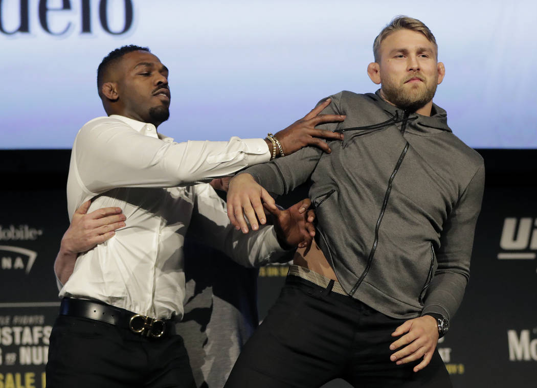 In this Nov. 2, 2018, file photo, Jon Jones, left, pushes Alexander Gustafsson out of the way during a news conference about their light heavyweight bout at Madison Square Garden in New York. (AP ...
