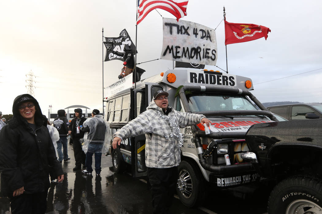 Andy Coronado shows off the fan bus he drove from Stockton, Calif., to tailgate in before what could be the last NFL game the Oakland Raiders play in the Oakland-Alameda County Coliseum in Oakland ...