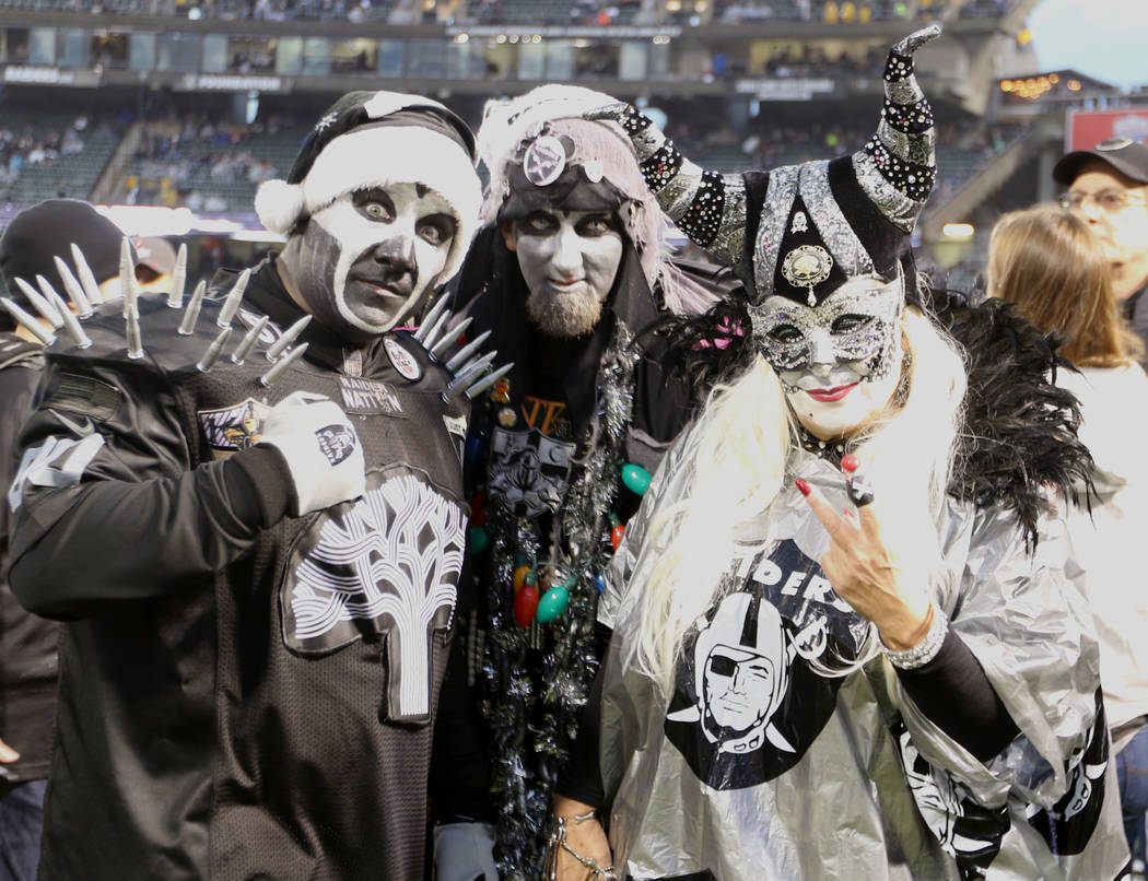Oakland Raiders fans on the sideline before the start of an NFL game against the Denver Broncos in Oakland, Calif., Monday, Dec. 24, 2018. Heidi Fang Las Vegas Review-Journal @HeidiFang