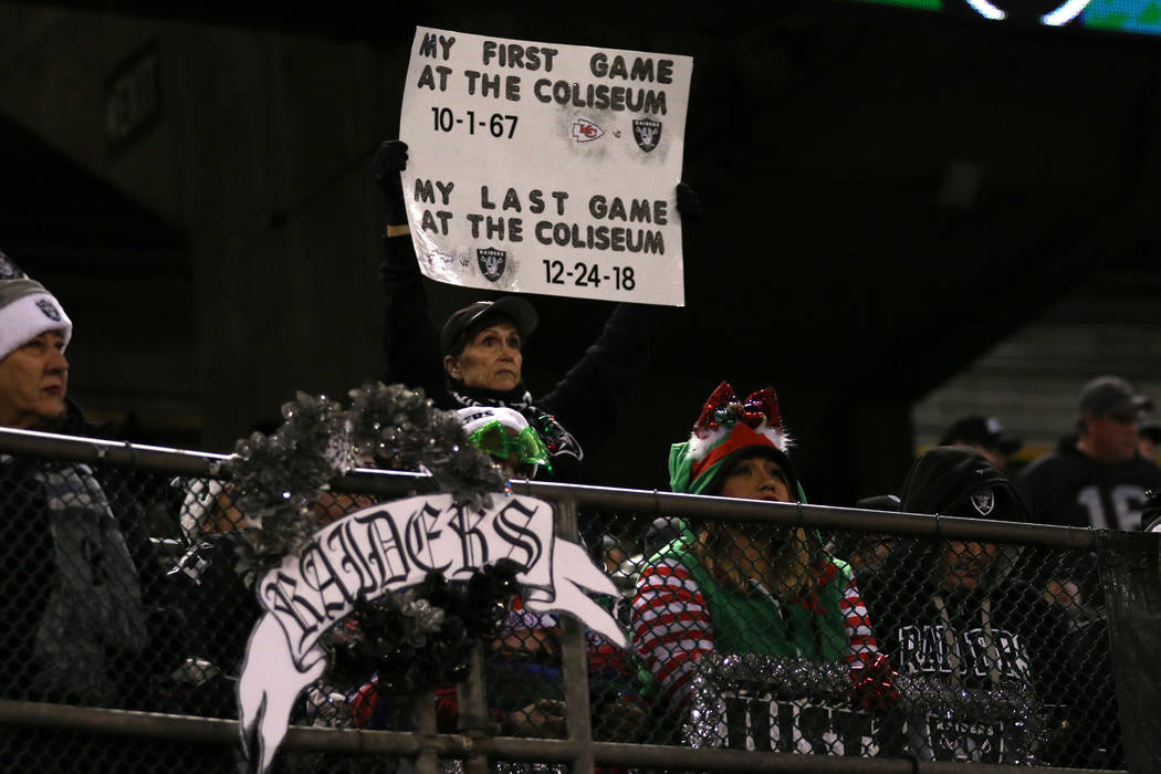 An Oakland Raiders fan holds up a sign during the first half of an NFL game against the Denver Broncos at the Oakland-Alameda County Coliseum in Oakland, Calif., Monday, Dec. 24, 2018. Heidi Fang ...