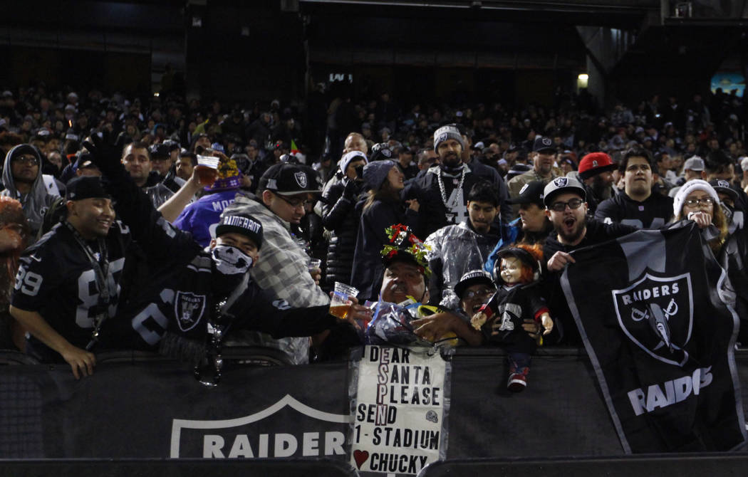Oakland Raiders fans pose during the first half of an NFL game against the Denver Broncos in Oakland, Calif., Monday, Dec. 24, 2018. Heidi Fang Las Vegas Review-Journal @HeidiFang