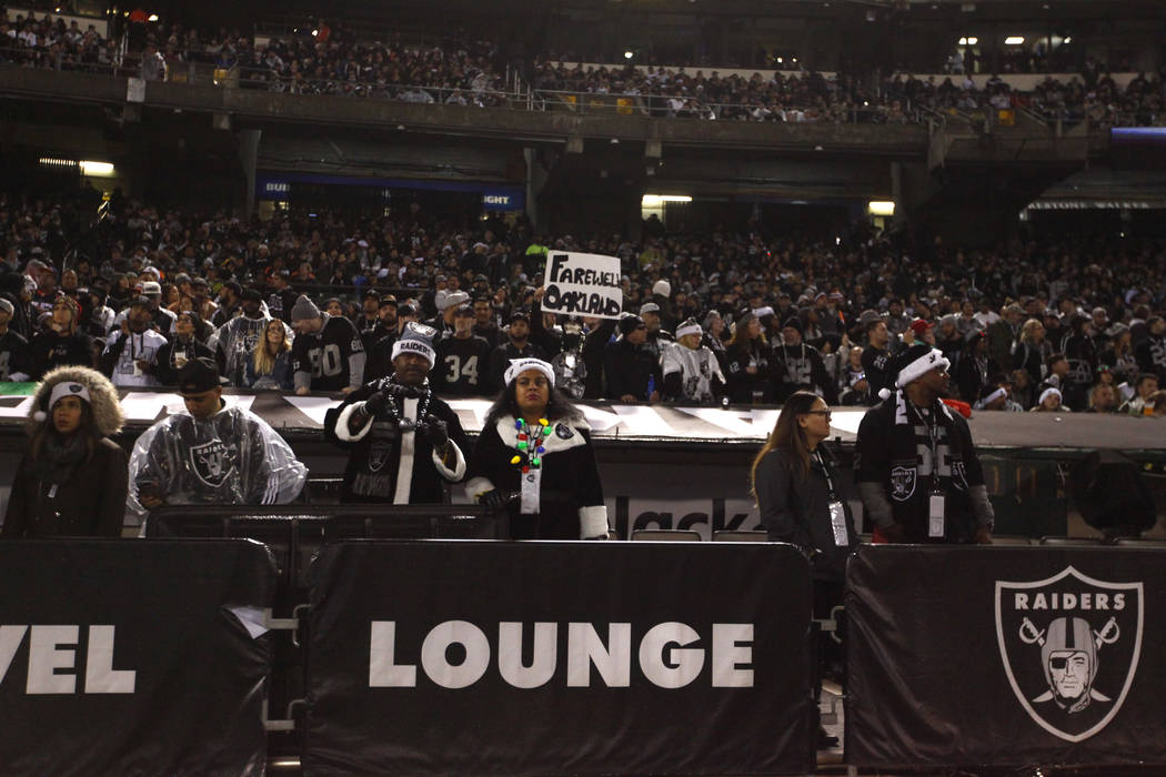 An Oakland Raiders fan holds up a sign on what could be the team's last game at the Oakland-Alameda County Coliseum during the first half of an NFL game against the Denver Broncos in Oakland, Cali ...