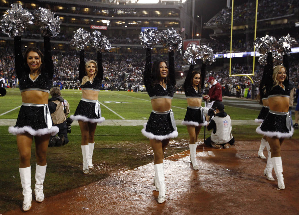 Oakland Raiders Raiderettes cheer during the first half of an NFL game against the Denver Broncos in Oakland, Calif., Monday, Dec. 24, 2018. Heidi Fang Las Vegas Review-Journal @HeidiFang