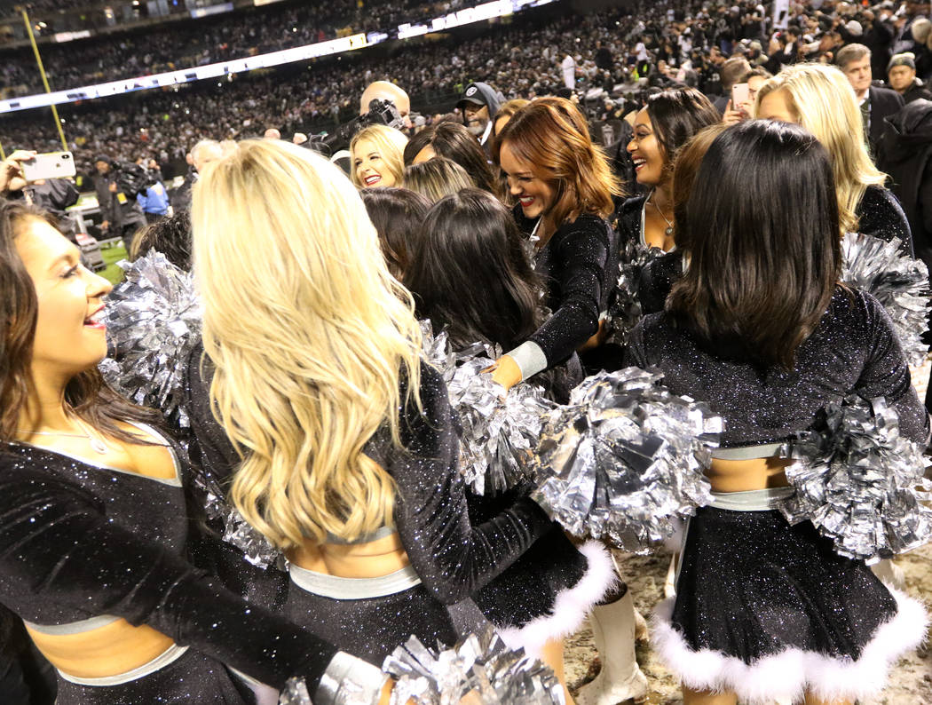 The Oakland Raiderettes hug after the team's win over the against the Denver Broncos in what could be the last game at the Oakland-Alameda County Coliseum in Oakland, Calif., Monday, Dec. 24, 2018 ...