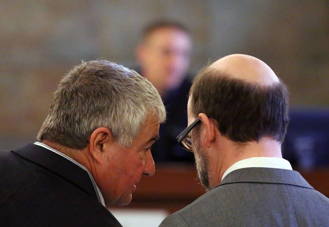 Henderson Constable, Earl Mitchell, left, consults with his attorney Dayvid Figler as Judge Joe Hardy Jr., center, presides during his first court appearance at the Regional Justice Center on Thur ...