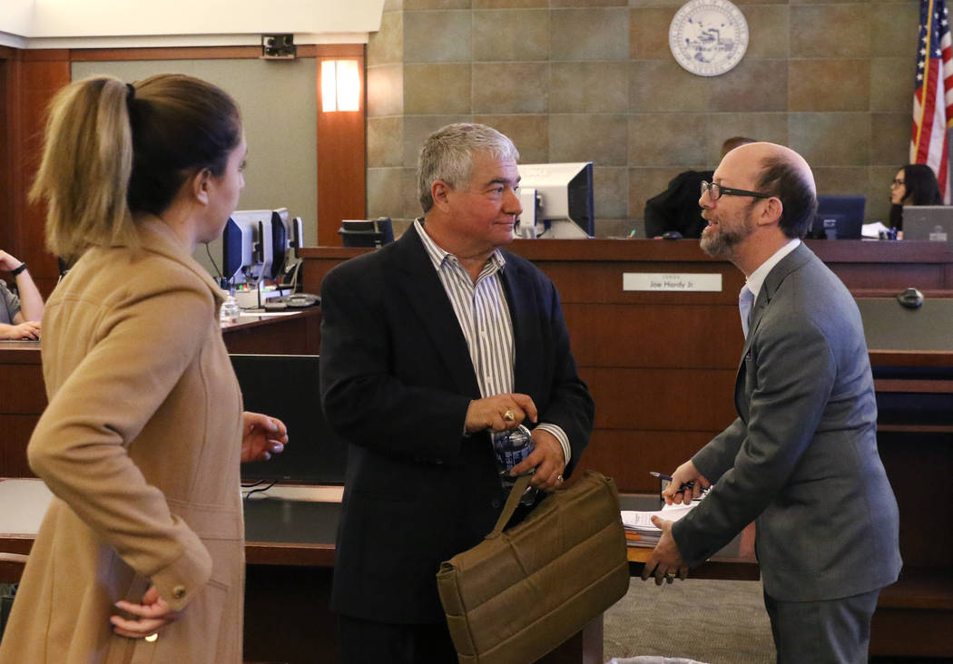 Henderson Constable Earl Mitchell, center, prepares to leave the courtroom with his attorneys, Alanna Bondy, left, and Dayvid Figler, after his first court appearance at the Regional Justice Cente ...