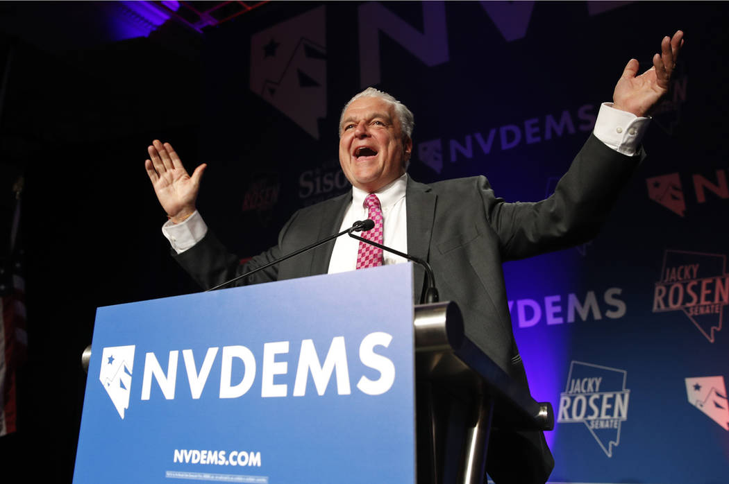 Clark County Commission Chair and Democratic gubernatorial candidate Steve Sisolak greets supporters after being elected governor Wednesday, Nov. 7, 2018, in Las Vegas. (AP Photo/John Locher)