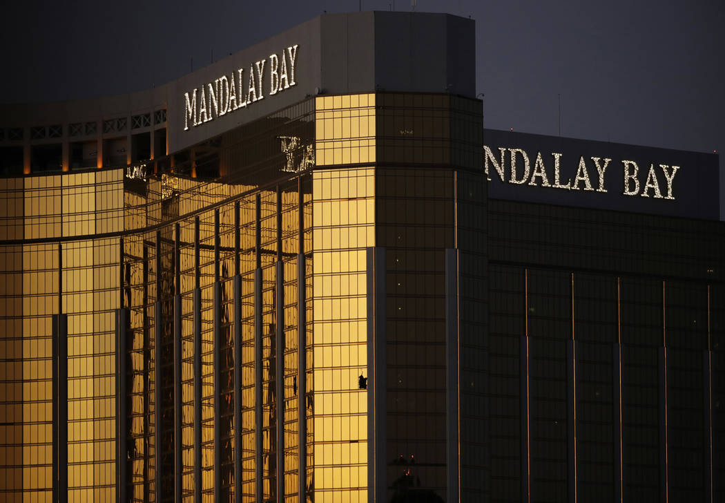 FILE - In this Oct. 3, 2017, file photo, windows are broken at the Mandalay Bay resort and casino in Las Vegas, the room from where Stephen Craig Paddock fired on a nearby music festival, killing ...