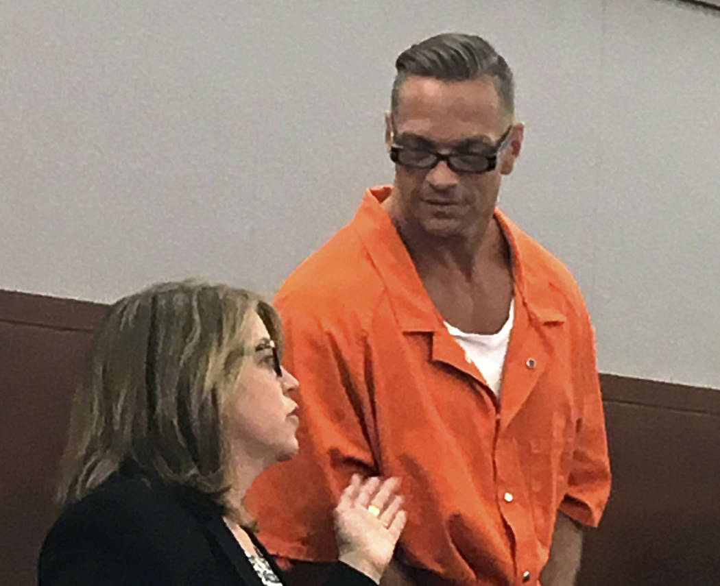 FILE - In this Aug. 17, 2017, file photo, Nevada death row inmate Scott Dozier, right, confers with Lori Teicher, a federal public defender involved in his case, during an appearance in Clark Coun ...