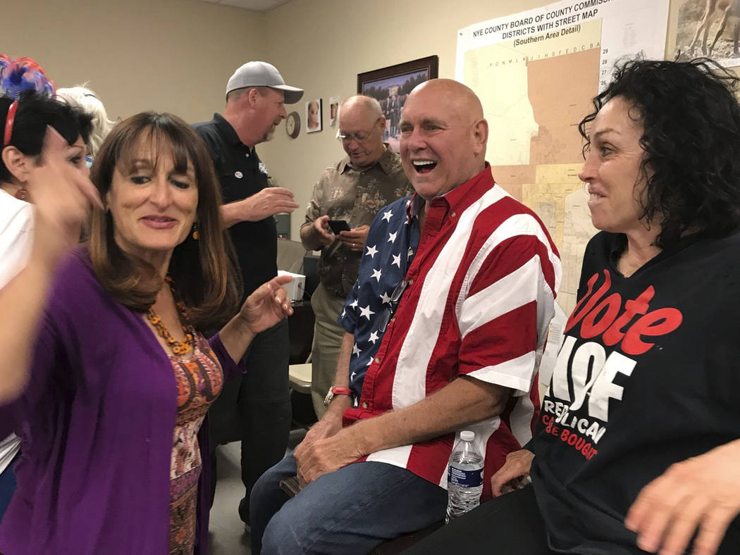 FILE - In this June 12, 2018, file photo, Nevada brothel owner Dennis Hof, second from right, celebrates with Heidi Fleiss, right, and others after winning the primary election in Pahrump, Nev. Ho ...