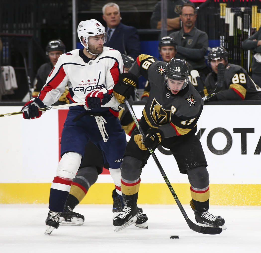 Golden Knights right wing Reilly Smith (19) moves the puck around  Washington Capitals right 80400a24ab94