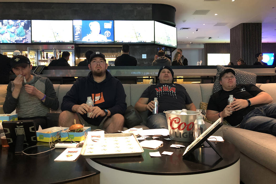 Dan Savel (left), Ryan Stasa, Nick Hollister and Zach Hollister watching Monday night football at the Fan Cage at The LINQ in Las Vegas on Monday, Dec. 3, 2018. (Todd Prince/Las Vegas Review-Journal)