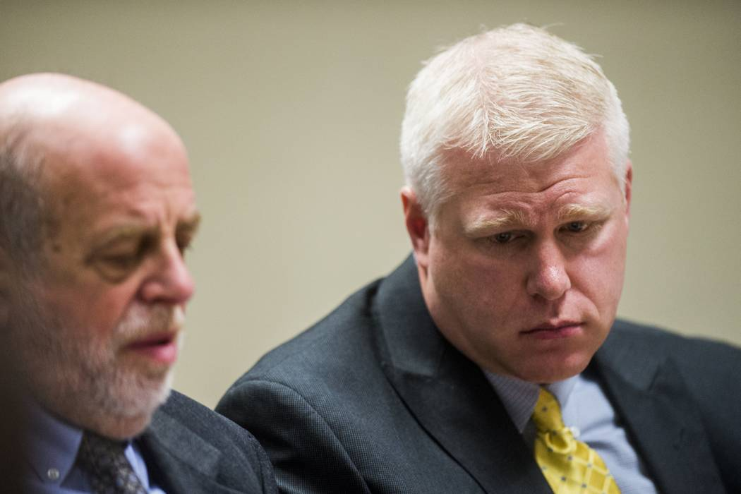 In this Jan. 10, 2018, file photo, Defendant Stephen Busch, right, listens at Flint District Court in Flint, Mich. Michael Prysby and Busch, two Michigan environmental regulators implicated in the ...