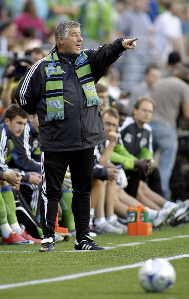 In this May 30, 2009, file photo, Seattle Sounders coach Sigi Schmid gestures from the sideline during the first half against the Columbus Crew in a MLS soccer match in Seattle. The match was Schm ...