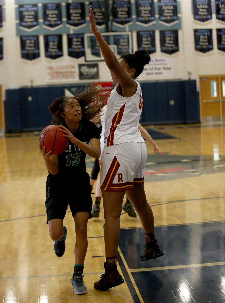 Palo Verde forward Kedrena Johnson (13) looks to shoot past Thomas Jefferson (Wash.) forward Nadira Eltayib (33) in the first quarter of their Las Vegas Holiday Classic Tournament prep basketball ...