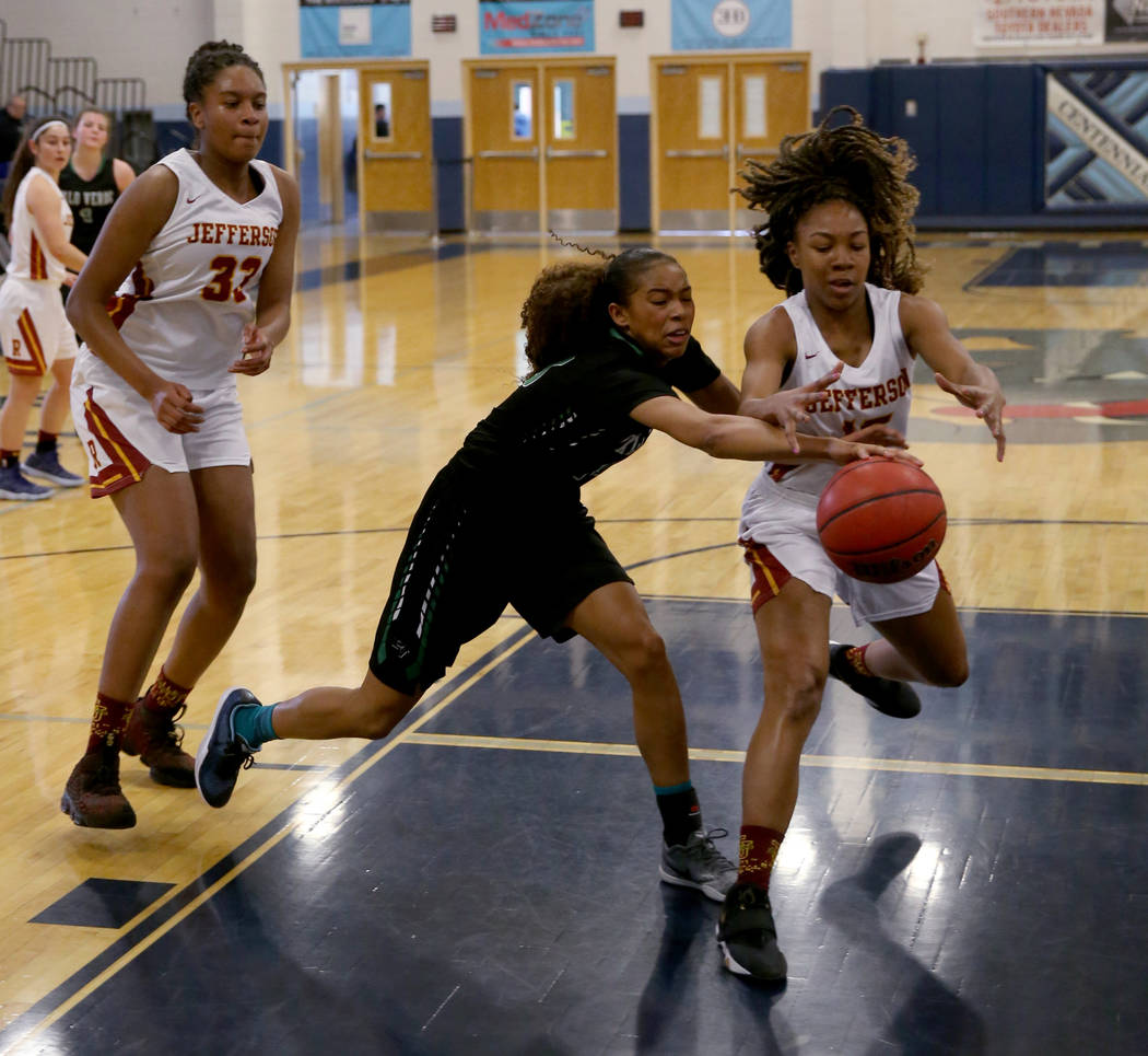 Palo Verde forward Kedrena Johnson, center, grabs a loose ball from Thomas Jefferson (Wash.) forward Gjianni White (15) as Jefferson forward Nadira Eltayib (33) looks on in the second quarter of t ...