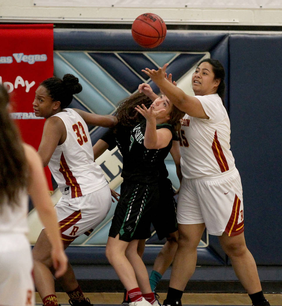 Palo Verde guard Jenna Kempf (3) goes for a loose ball between Thomas Jefferson (Wash.) forwards Nadira Eltayib (33) and Hila Vei'koso (45) in the first quarter of their Las Vegas Holiday Classic ...
