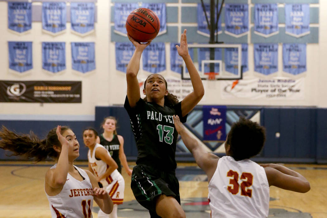 Palo Verde forward Kedrena Johnson (13) shoots between Thomas Jefferson (Wash.) guard Amy Holden (11) and forward Aunna Mitchell (32) in the fourth quarter of their Las Vegas Holiday Classic Tourn ...
