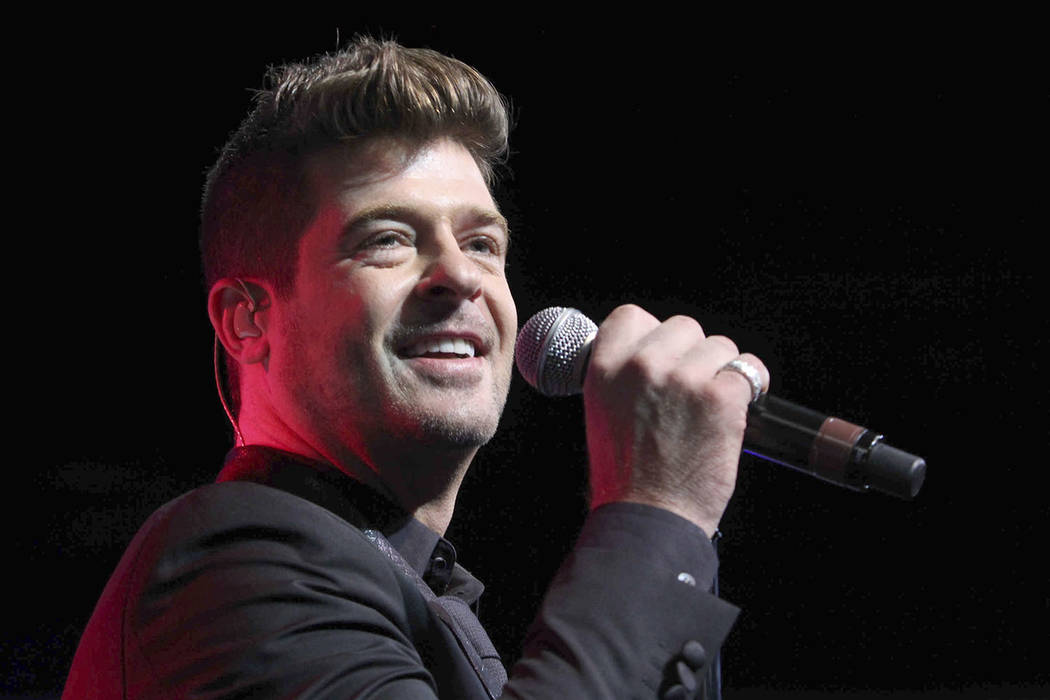 """In this Aug. 7, 2015, file photo, Robin Thicke performs during the Steve Harvey Morning Show live broadcast at the Georgia World Congress Center in Atlanta. The 41-year-old """"Blurred Lines"""" singer ..."""