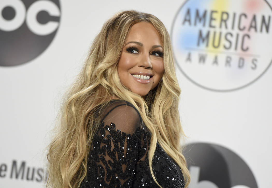 FILE - In this Oct. 9, 2018 file photo, Mariah Carey poses in the press room at the American Music Awards at the Microsoft Theater in Los Angeles. Carey's 24-year-old Christmas classic is s ...