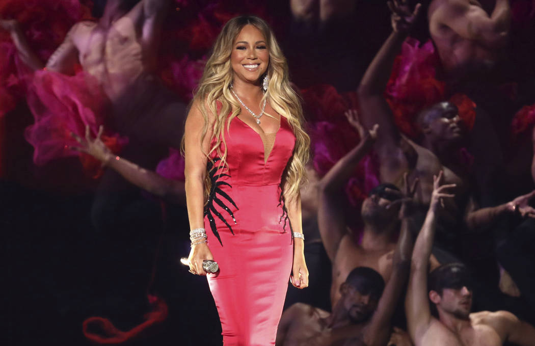 """Mariah Carey performs """"With You"""" at the American Music Awards on Tuesday, Oct. 9, 2018, at the Microsoft Theater in Los Angeles. (Photo by Matt Sayles/Invision/AP)"""
