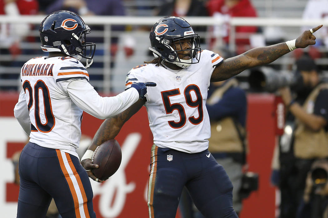 Chicago Bears inside linebacker Danny Trevathan (59) celebrates with Prince Amukamara after intercepting a pass against the San Francisco 49ers during the second half of an NFL football game in Sa ...