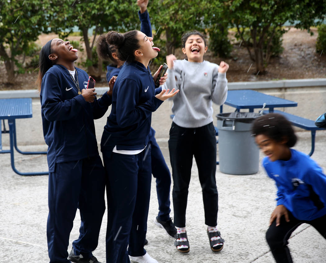 Centennial High School basketball players, from left, Teionni McDaniel, 16, Jessenia Lawson, 15, Kalyn Miller, 15, and Elin Guzelkucuk, 14, play in a light snow before their team's game at the Las ...