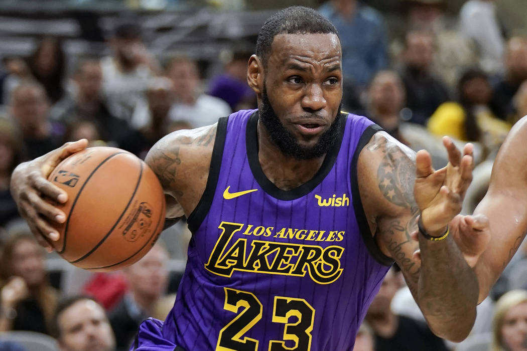 In this Dec. 7, 2018, file photo, Los Angeles Lakers' LeBron James (23) drives against the San Antonio Spurs during the first half of an NBA basketball game, in San Antonio. (AP Photo/Darren Abate ...