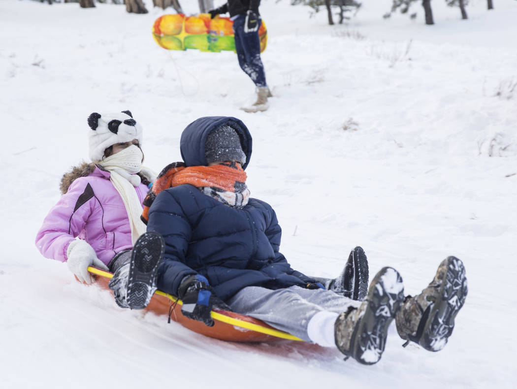 Natalie Anderson, left, 12, and brother Joey, 13, ride their sled at Lee Meadows on Friday, Nov. 30, 2018, outside Lee Canyon, in Las Vegas. Benjamin Hager Las Vegas Review-Journal