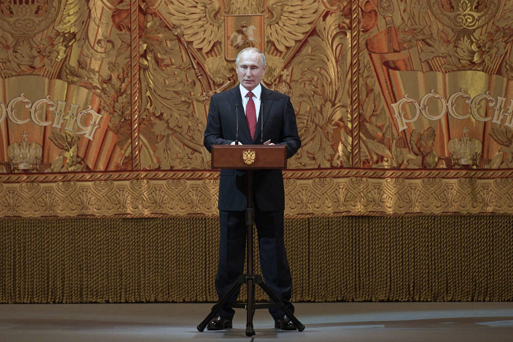 President Vladimir Putin addresses a gala event to mark the upcoming New Year 2019 at the Bolshoi Theater, in Moscow, Russia, Thursday, Dec. 27, 2018. (Alexei Druzhinin, Sputnik, Kremlin Pool Phot ...