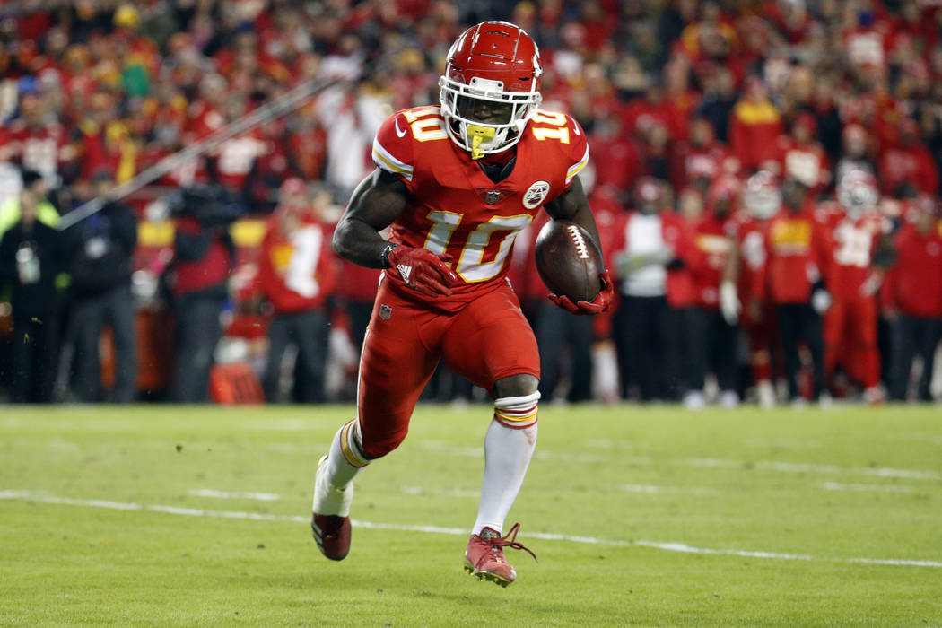 Kansas City Chiefs wide receiver Tyreek Hill (10) runs with the ball during the first half of an NFL football game against the Los Angeles Chargers in Kansas City, Mo., Thursday, Dec. 13, 2018. (A ...