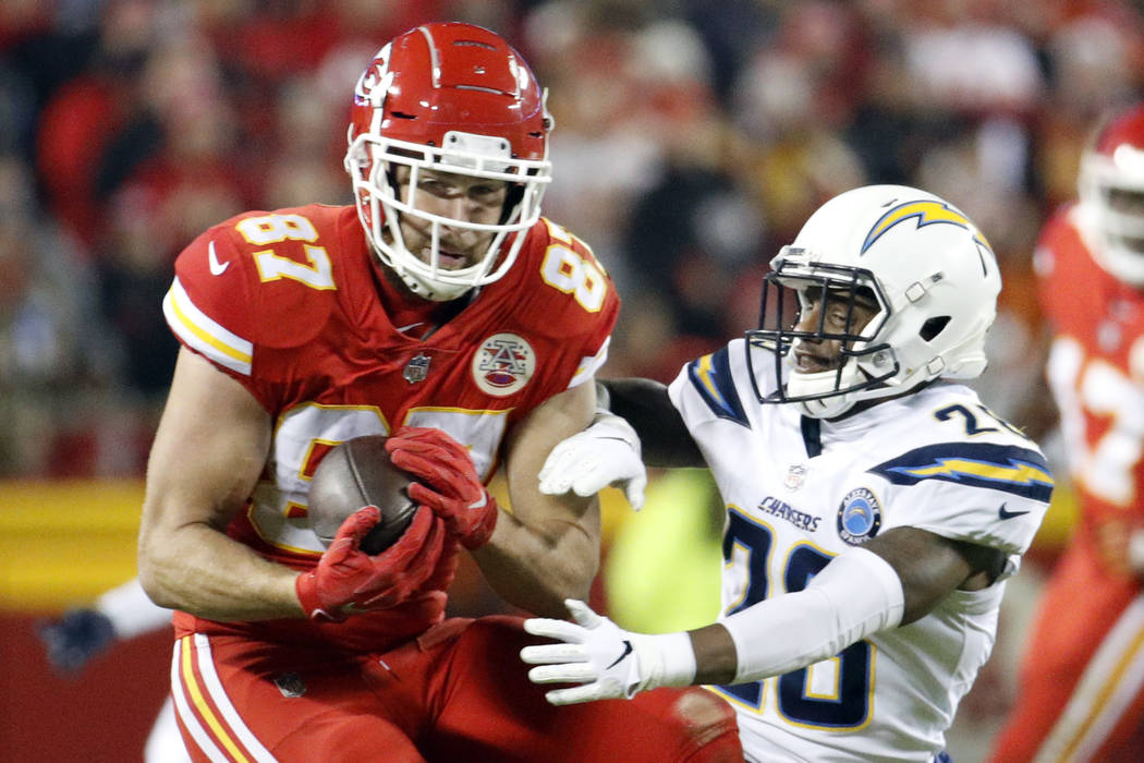 Kansas City Chiefs tight end Travis Kelce (87) makes a catch against Los Angeles Chargers cornerback Casey Hayward (26) during the second half of an NFL football game in Kansas City, Mo., Thursday ...