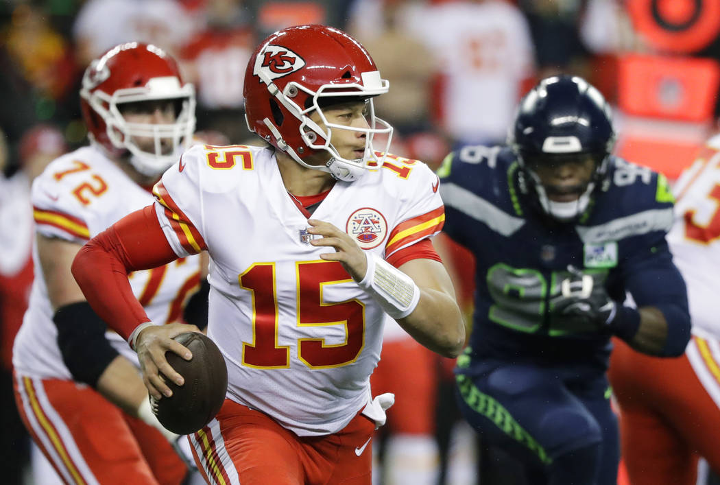 Kansas City Chiefs quarterback Patrick Mahomes (15) looks to pass against the Seattle Seahawks during the first half of an NFL football game, Sunday, Dec. 23, 2018, in Seattle. (AP Photo/Elaine Th ...