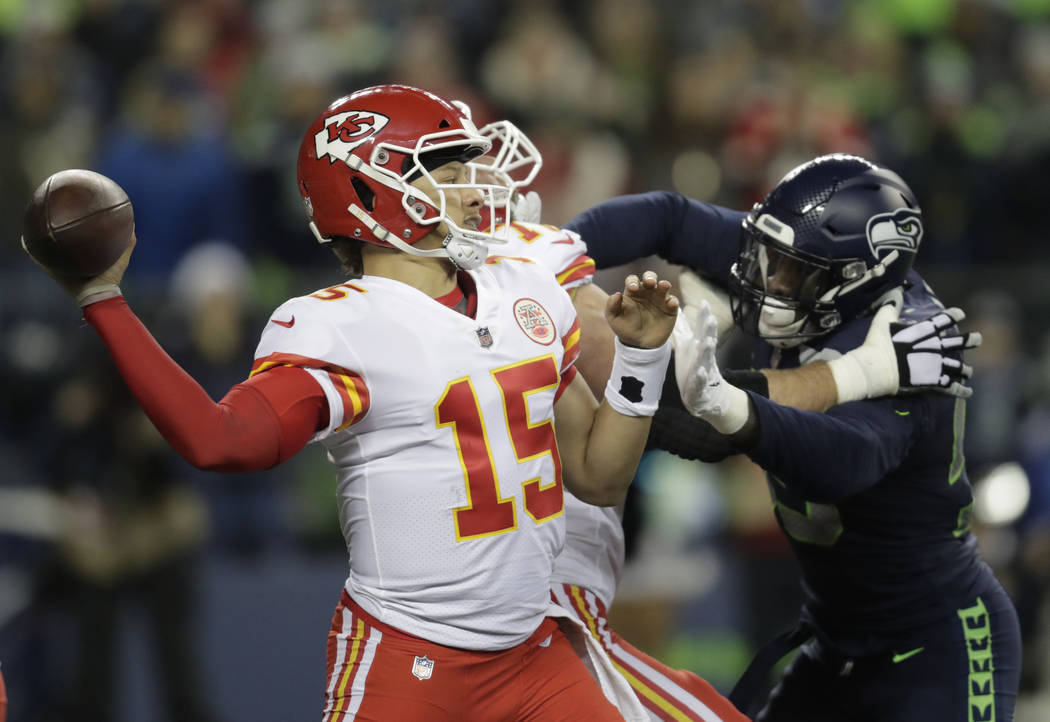 Kansas City Chiefs quarterback Patrick Mahomes (15) passes against the Seattle Seahawks during the second half of an NFL football game, Sunday, Dec. 23, 2018, in Seattle. (AP Photo/Stephen Brashear)