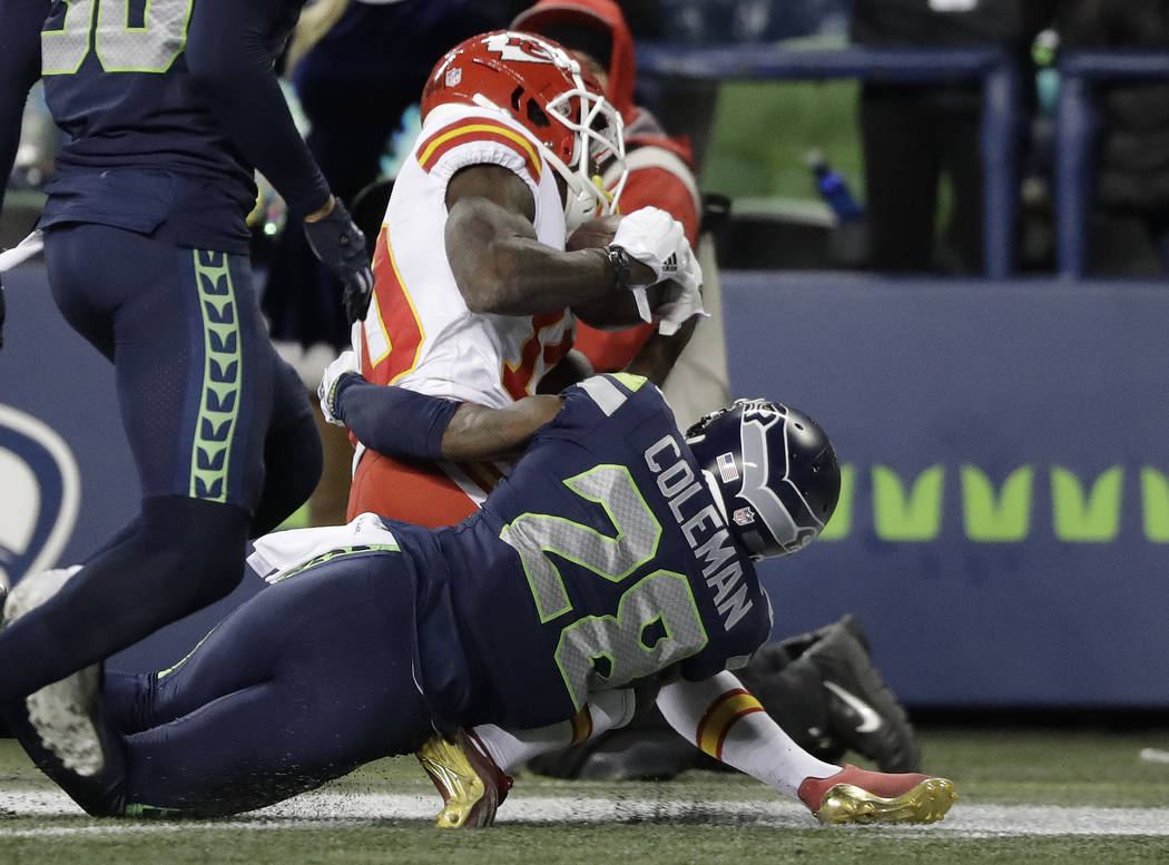 Kansas City Chiefs wide receiver Tyreek Hill injures his foot as he is tackled by Seattle Seahawks cornerback Justin Coleman (28) during the second half of an NFL football game, Sunday, Dec. 23, 2 ...