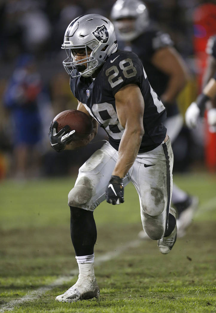 Oakland Raiders running back Jalen Richard (30) runs against the Denver Broncos during the second half of an NFL football game in Oakland, Calif., Monday, Dec. 24, 2018. (AP Photo/D. Ross Cameron)