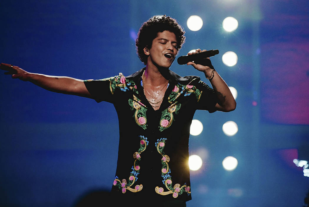"""This image released by CBS shows Bruno Mars during a taping of his first primetime television special, """"Bruno Mars: 24K Magic Live at the Apollo."""" (Florent Déchard/CBS via AP)"""