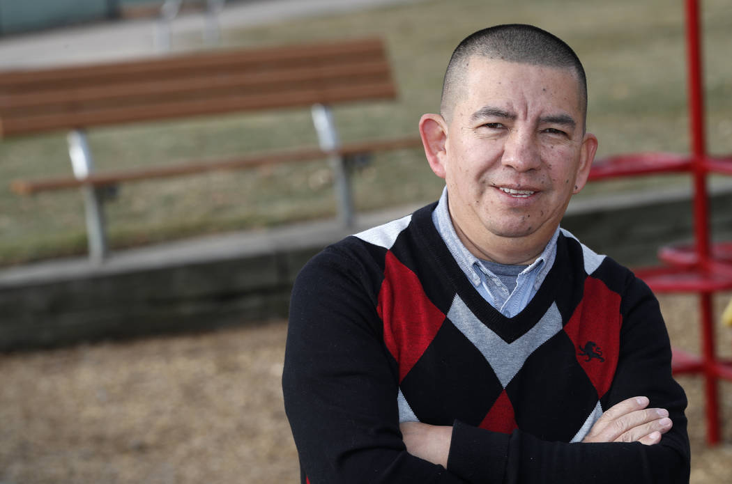 FILE - In this, Dec. 15, 2018, file photo, Pedro H. Gonzalez, bi-vocational Denver pastor and board member of Colorado Family Action, poses for a photograph in Clement Park in Littleton, Colo. Rep ...
